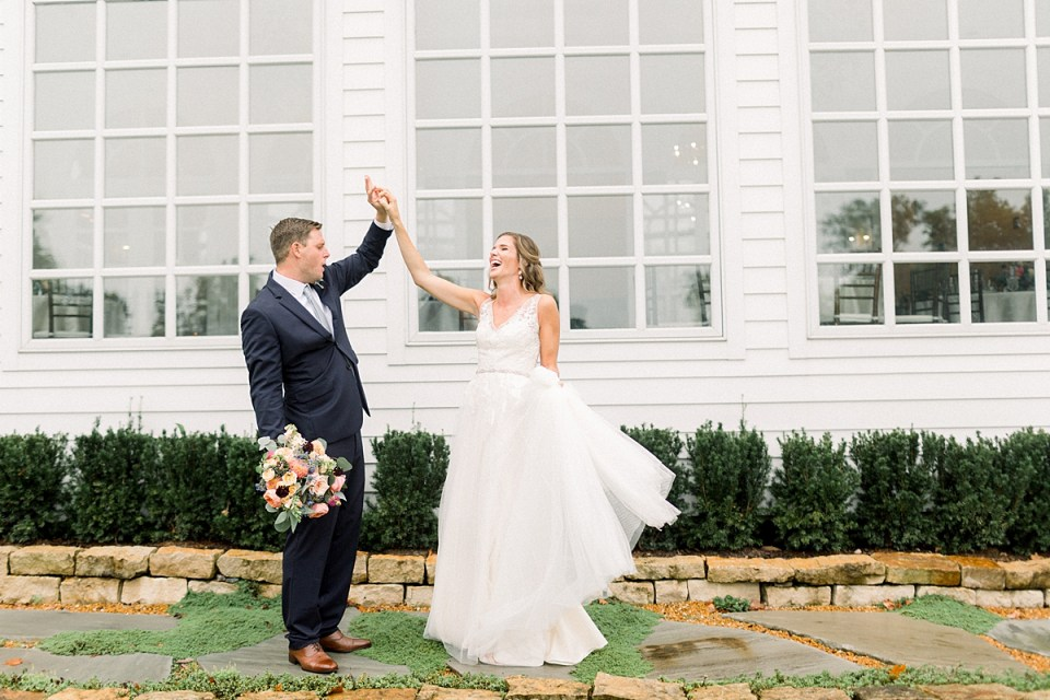 Arielle Peters Photography | Bride and groom dancing outside in the rain at Sycamore Hills Golf Club in Fort Wayne, Indiana on wedding day.
