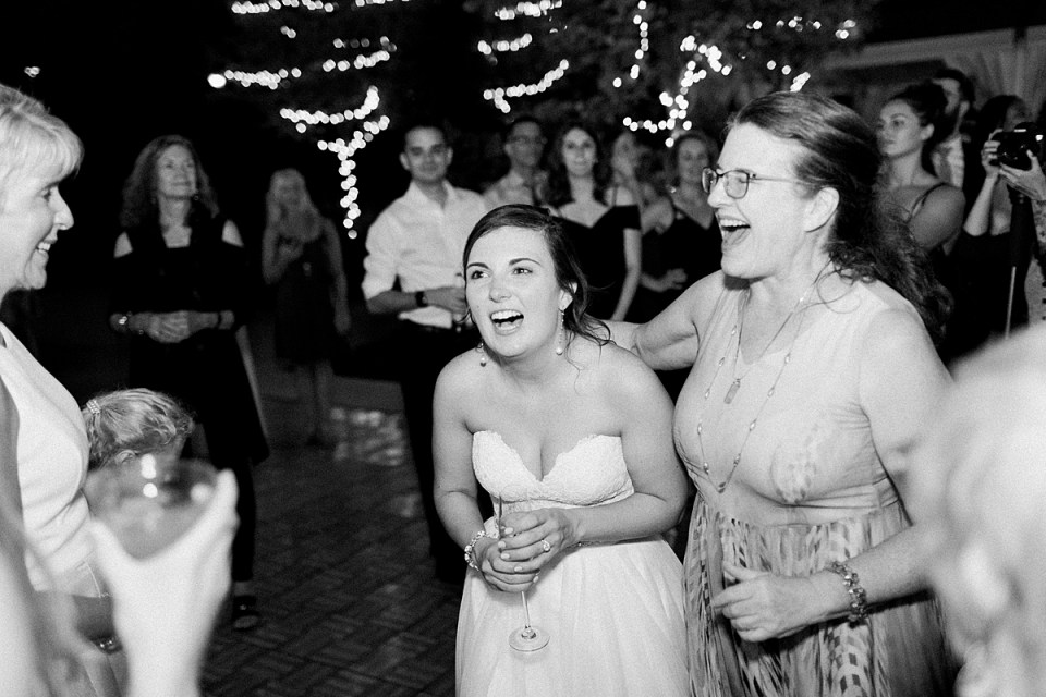 Arielle Peters Photography | Bride laughing at wedding reception at The Bridgewater Club in Carmel, Indiana on wedding day.