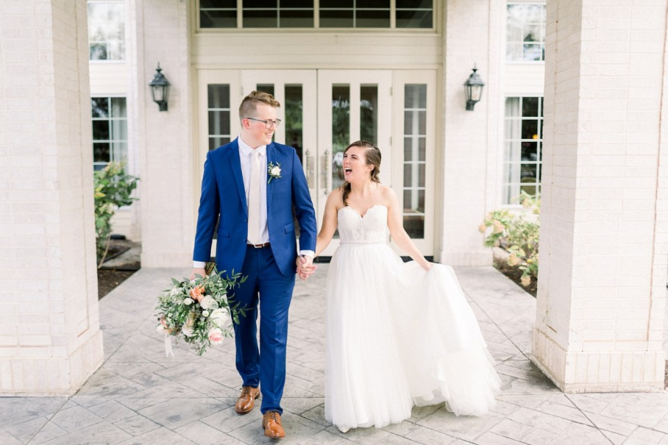 Arielle Peters Photography | Bride and groom smiling and walking outside at The Bridgewater Club in Carmel, Indiana on wedding day.