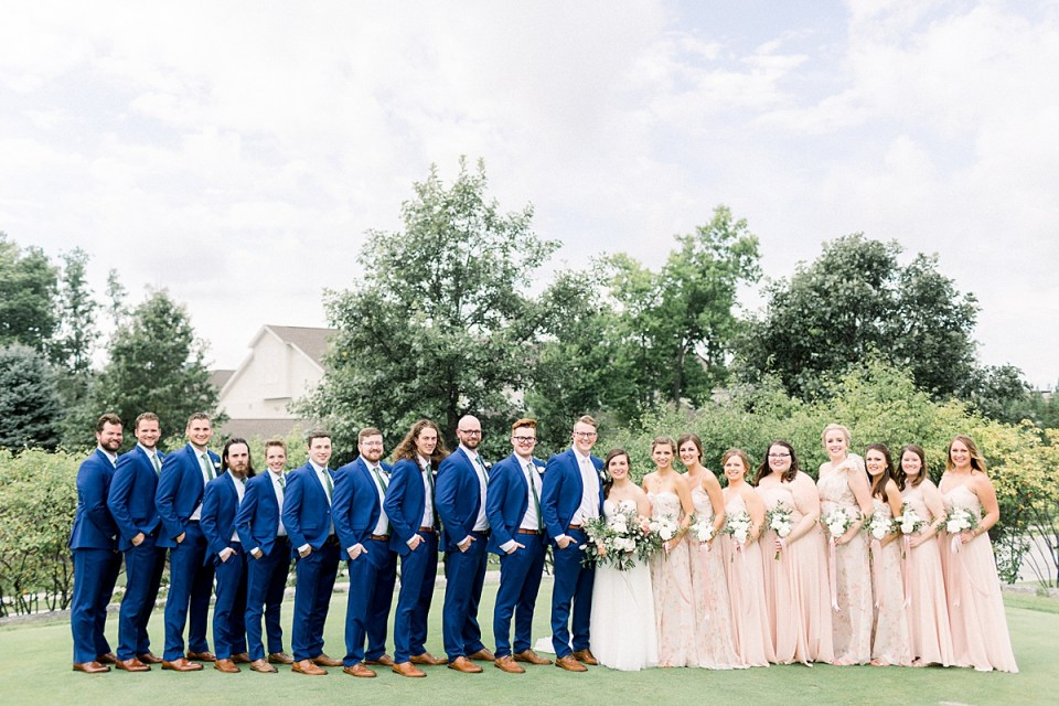 Arielle Peters Photography | Wedding party smiling outside at The Bridgewater Club in Carmel, Indiana on wedding day.