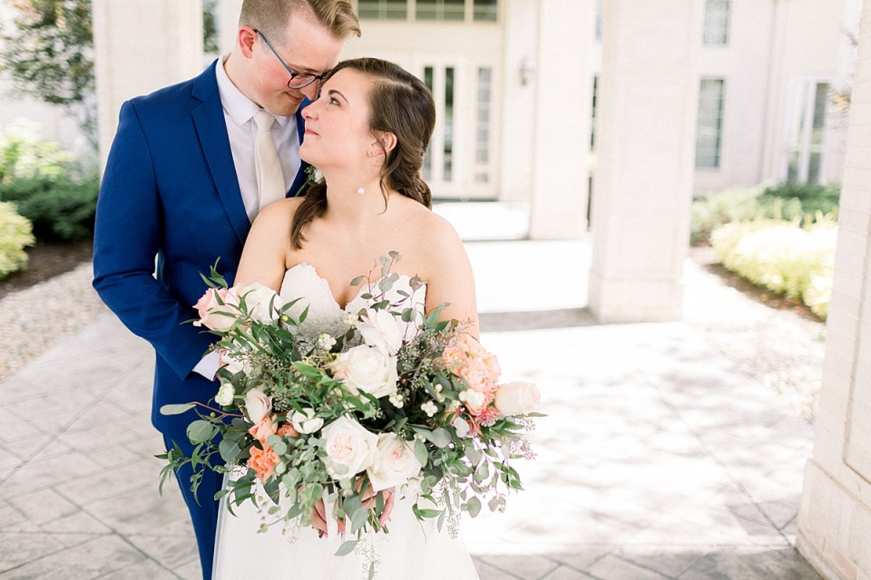 Arielle Peters Photography | Bride and groom smiling at each other outside at The Bridgewater Club in Carmel, Indiana on wedding day.