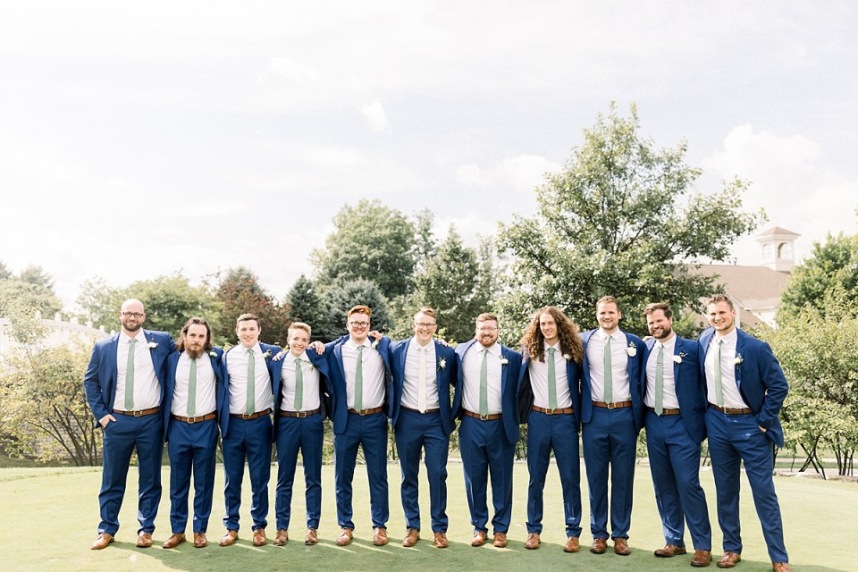 Arielle Peters Photography | Groom and groomsmen smiling outside at The Bridgewater Club in Carmel, Indiana on wedding day.