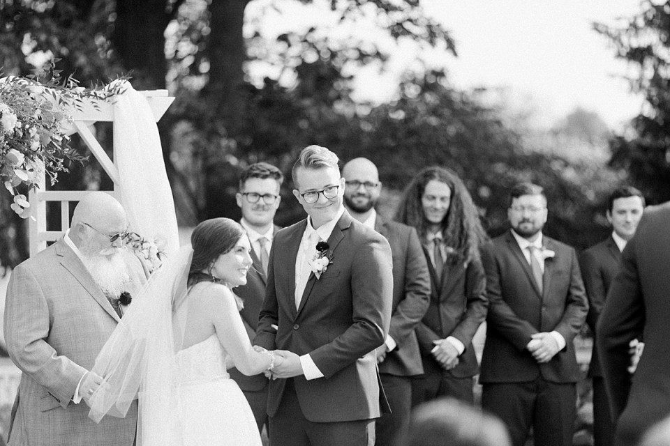 Arielle Peters Photography | Bride and groom holding hands at the alter at The Bridgewater Club in Carmel, Indiana on wedding day.