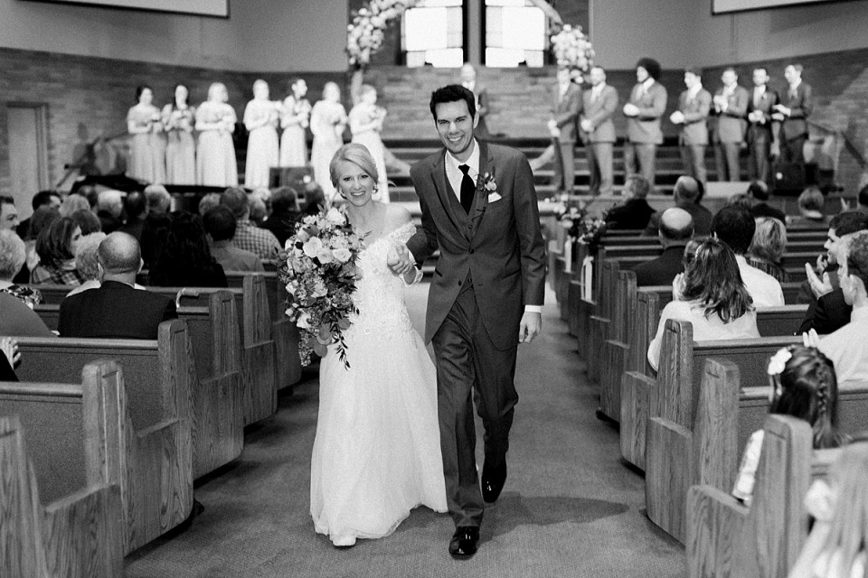 Arielle Peters Photography | Bride and groom walking down the aisle together on fall wedding day.