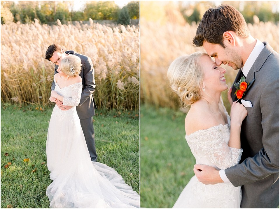 Arielle Peters Photography | Groom holding the bride in his arms outside in field on fall wedding day.