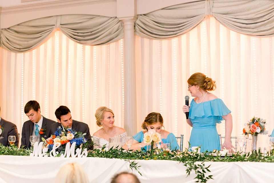 Arielle Peters Photography | Sister of the bride giving speech at fall wedding reception.
