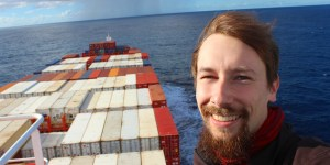 Sustainable Travel Guide. Arimo Koo on a container ship.