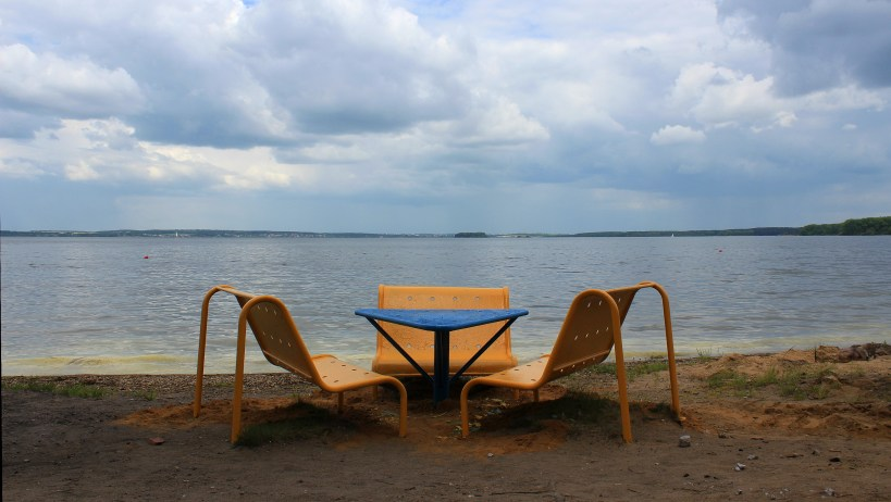 Chairs and a small table by the Minsk Sea, an artificial lake near Minsk.