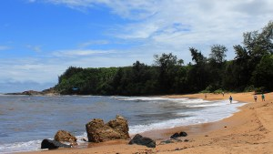 The beautiful Om Beach with a few people walking in the sand in the distance during my stay in Gokarna.