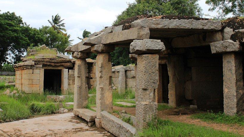 A partly outgrown ruin in Hampi.