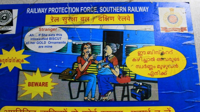 """Survival tips for India: an official sign warning about """"intoxicated BISCUTS"""" on a train in India."""