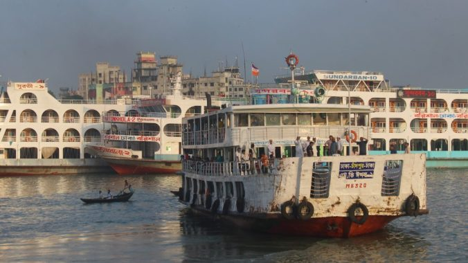 A Rocket ship leaving from Dhaka on the river by sunset in Bangladesh. Solo travel Bangladesh.