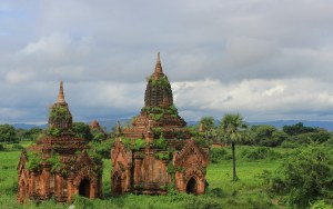Two small temples in Bagan, Myanmar slightly covered in moss.