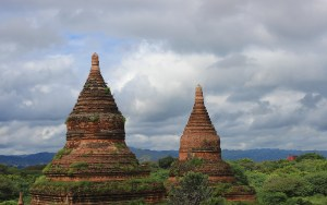 Two round and cone-shaped temple rooftops in Bagan, Myanmar.