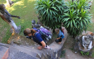 Two German backpackers climing steep stairs in Buddha Park (Wat Xieng Khuan).