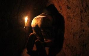 Crawling inside the Cu Chi tunnels.