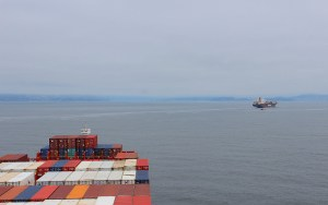 Two freighter ships approaching San Francisco on the Pacific.