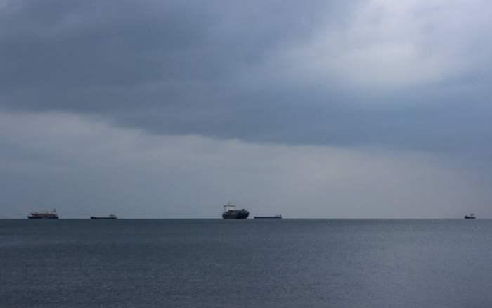 Cargo ships outside Thessaloniki on the horizon