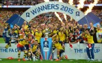 The Arsenal team pose with the trophy after winning the FA Cup final football match between Aston Villa and Arsenal at Wembley stadium in London on May 30, 2015.       AFP PHOTO / GLYN KIRK  NOT FOR MARKETING OR ADVERTISING USE / RESTRICTED TO EDITORIAL USEGLYN KIRK/AFP/Getty Images
