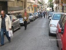 pedestrians in a Greek street