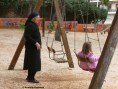 Grandmother and granddaughter at a playground, Athens, Greece