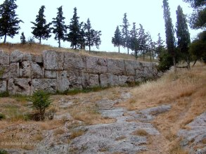 The massive retaining wall of the 3rd phase and a road leading to it.