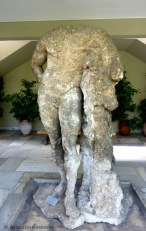 This badly damaged statue of Hercules is recognized by his trademark pose, with club and lion skin.
