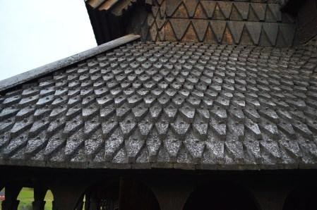The effect of the shaped, riven oak shingles is striking.