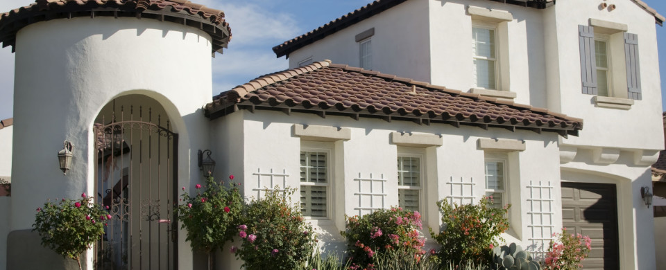 Fascia And Tan Shutters Brick House
