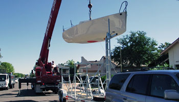 The Mini 6.50 is craned onto its trailer.
