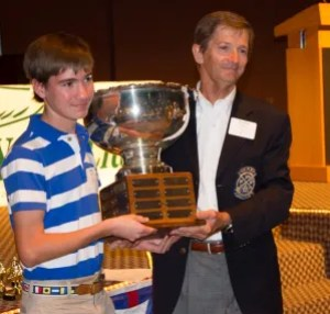 Martin Lorch and son Cedric heft the Club Championship trophy. It's been a good year for Cedric, winning the High School Championship and two Blunder Buckets!
