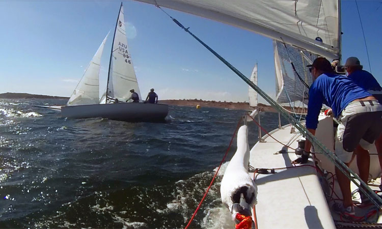 That's Greg Jackson and crew knocked down and dragging the spinnaker during a Sunday puff at Lake Pleasant. Photo: Mike Ferring's rail-mounted GoPro