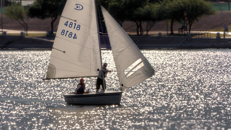 Mike sets the whisker pole for Maryellen at the Ruth Beals Cup Regatta. Photo: Bill Cunningham