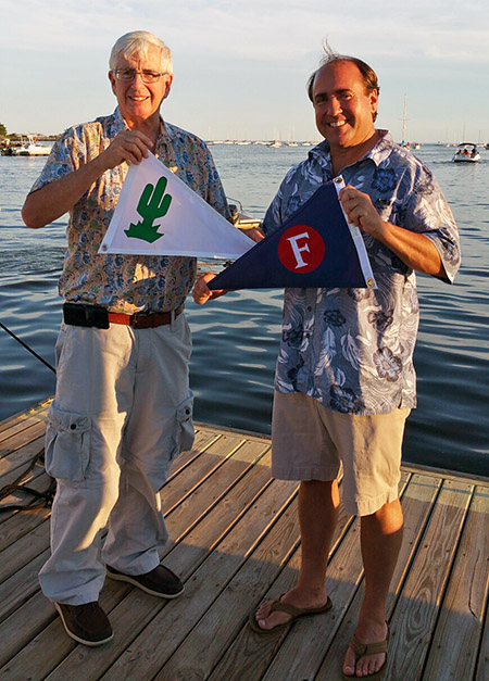 AYC member Bill Cunningham exchanges burgees with Johnpatrick O'Brien, Rear Commodore of Fayerweather Yacht Club in Black Rock Harbor, Connecticut.