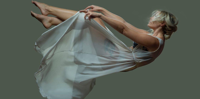 a falling woman wearing a sheer dress