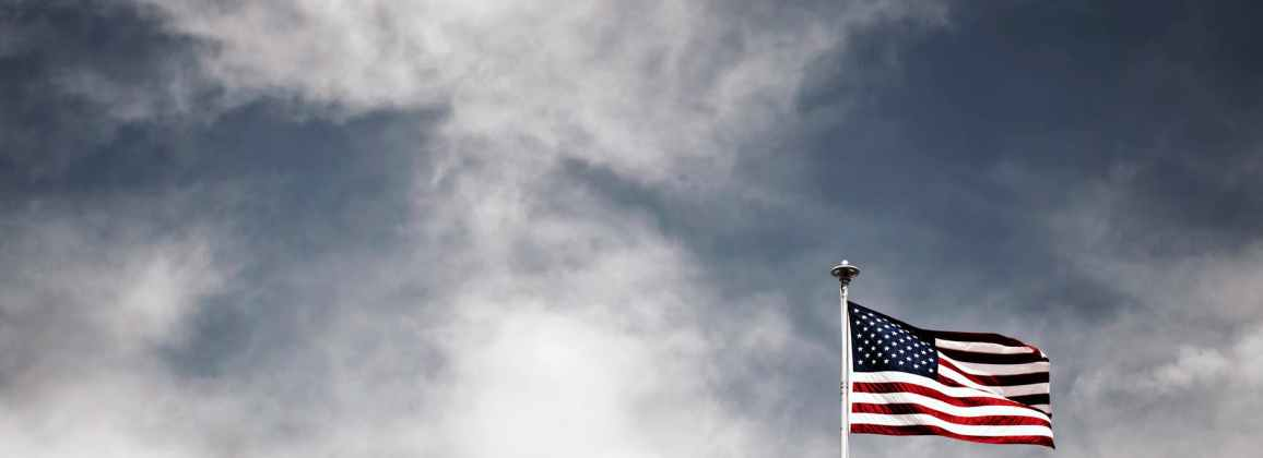 American flag and clouds in sky