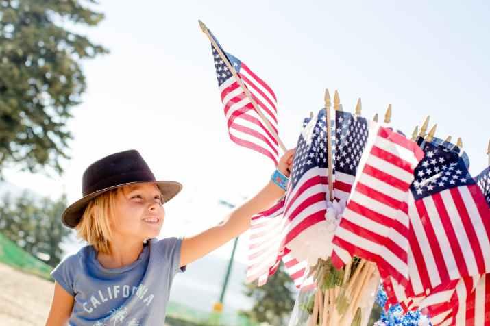 Child holding usa flag