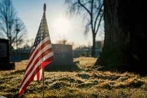American flag on brown grass field