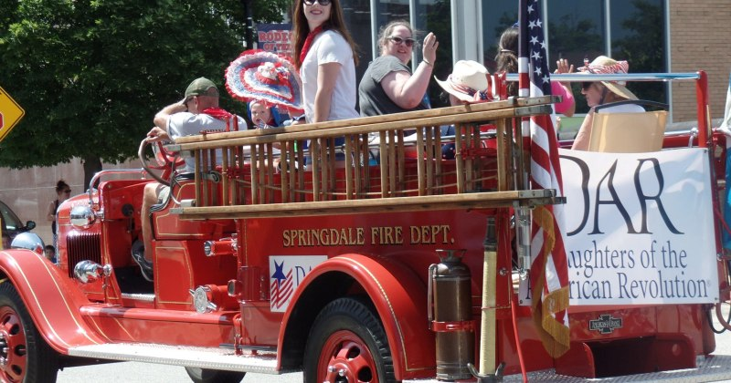 DAR ladies on old fire truck in Independence Day Parade