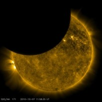 On Oct. 7, 2010, NASA's Solar Dynamics Observatory, or SDO, observed its first lunar transit when the new moon passed directly between the spacecraft (in its geosynchronous orbit) and the sun. With SDO watching the sun in a wavelength of extreme ultraviolet light, the dark moon created a partial eclipse of the sun. Image Credit: NASA