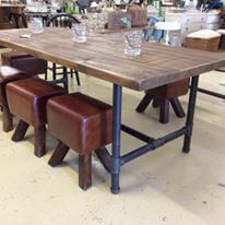 Vintage style metal pipe base industrial table.