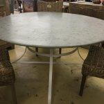 Round metal table, galvanised top.