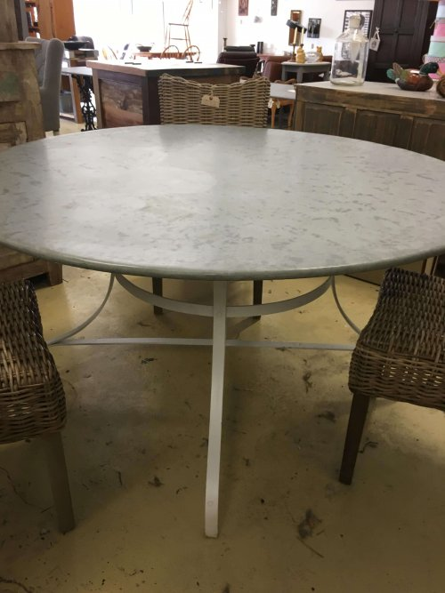 Round metal table, galvanised top.
