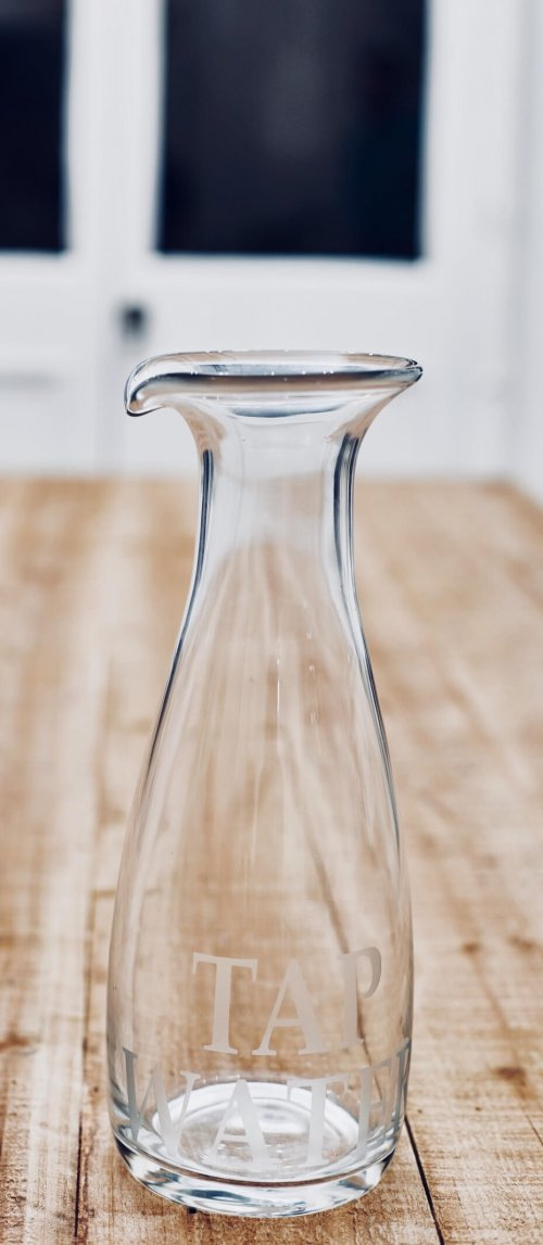 Glass Water Carafe This glass tap water decanter/carafe is an absolute classic. Simple in form with a touch of humour and looks great on any table or in any kitchen.