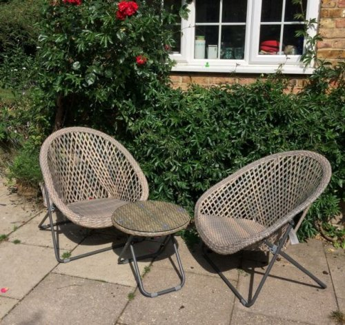 Garden furniture. 2 Chairs and and a table. Beautiful grey/green faux rattan set. See picture for detail. These look absolutely stunning and are also fantastic quality which is made to last! The chairs and table fold to enable storage when not in use. Camber