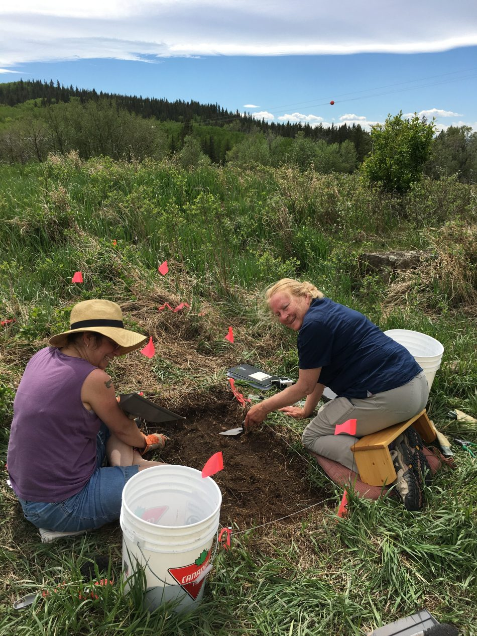 Katherine Peterson and Christine Hayes excavating the third unit full of artifacts