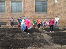 Spreading the compost on what will be our vegetable garden.