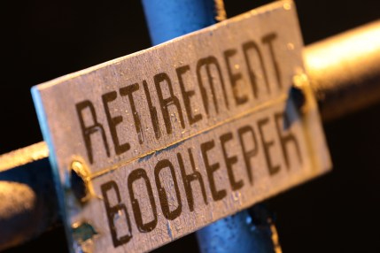 """A sign reserving a parking space in the back of Arlington High School for the """"retirement bookeeper."""" The word bookkeeper is the only word in the english language to have three consecutive repeating letters with no hyphens--except in this case. December 17, 2011."""