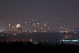 From Robbins Farm, the odd firework could still be seen lighting up the hazy night sky all over the eastern horizon after the main Boston fireworks show had ended. July 4, 2012.