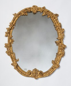 Decorative mirror with gold leaf ornamentation